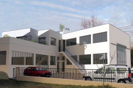 Surélévation d'un entrepôt pour l'agrandissement d'un appartement existant