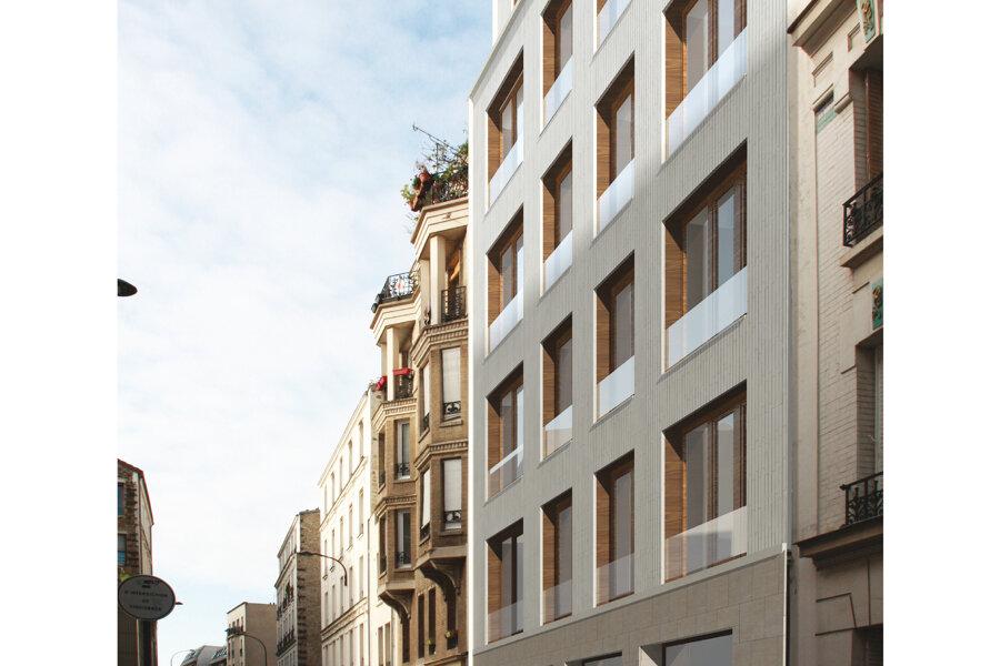 Construction d'un immeuble de 9 logements et d'un local d'activité
